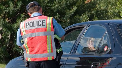 Policeman on the job writing a ticket