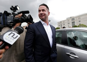 """In this Sept. 24, 2014, file photo, reporters gather around Michael """"The Situation"""" Sorrentino as he leaves the MLK Jr. Federal Courthouse in Newark, N.J., after a court appearance. Michael Sorrentino and his brother Marc Sorrentino are set to appear in court to face additional tax fraud charges are scheduled to be arraigned on Monday, April 17, 2017, in federal court in Newark. They previously pleaded not guilty to charges they filed bogus tax returns on nearly $9 million and claimed millions in personal expenses as business expenses. (AP Photo/Julio Cortez, File)"""