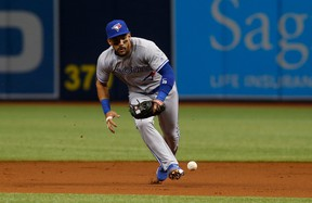 Second baseman Devon Travis of the Toronto Blue Jays makes an attempt to field the infield single by Mallex Smith of the Tampa Bay Rays on April 8, 2017 at Tropicana Field in St. Petersburg, Florida. (Brian Blanco/Getty Images)