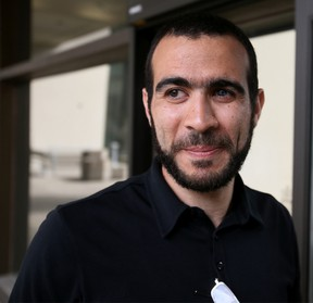 Omar Khadr stands outside the Edmonton Law Courts Buildings on May 7, 2015 after Alberta's highest court released the former Guantanamo Bay detainee on bail pending the appeal of his convictions in the United States. (Tom Braid/Postmedia Network/Files)