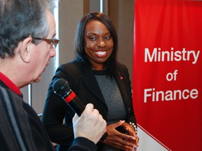 Mitzie Hunter looks on as Peterborough MPP Jeff Leal addresses participants during a consultation on the Ontario Retirement Pension Plan (ORPP) held at the Holiday Inn in Peterborough, Jan. 22, 2015. (Clifford Skarstedt/Peterborough Examiner/Postmedia Network)