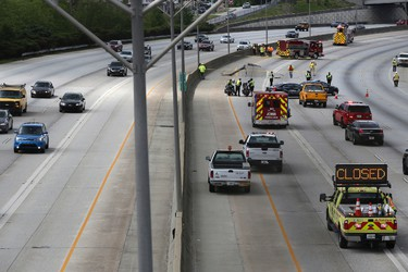 Construction section off a part of Interstate 20 West that buckled in Decatur, Ga., Monday, April 17, 2017.  (Henry Taylor/Atlanta Journal-Constitution via AP)