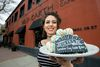 Madeline Slind holds a plate of Oilers cake bites at the Wild Earth Bakery & Cafe, 8902 99 St., in Edmonton on Monday, April 17, 2017.