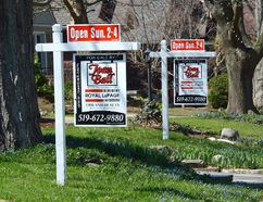 Real estate signs on Devonshire Avenue in London. (MORRIS LAMONT, The London Free Press)