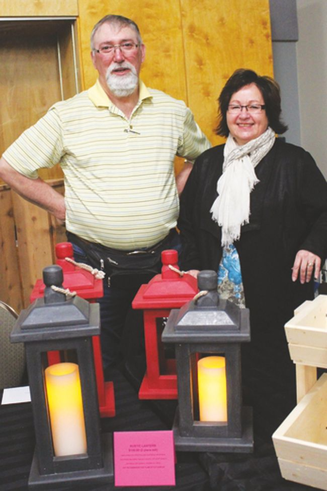 Bob and Marilyn Whaley display some of their handcrafted lamps during the Home Party Expo held April 8 and 9.