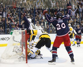 Columbus Blue Jackets' Markus Nutivaara, left, of Finland, and Brandon Saad celebrate a goal against the Pittsburgh Penguins during the second period of Game 4 of an NHL first-round hockey playoff series Tuesday, April 18, 2017, in Columbus, Ohio. (AP Photo/Jay LaPrete)