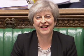 A still image taken from footage broadcast by the UK Parliamentary Recording Unit (PRU) on April 19, 2017 shows British Prime Minister Theresa May laughing during Prime Ministers questions in the House of Commons in London. Britain's parliament votes today on holding a snap election in June, as Prime Minister Theresa May seeks to make strong gains against the opposition before gruelling Brexit negotiations. / (PRU AND AFP PHOTO/ Handout)