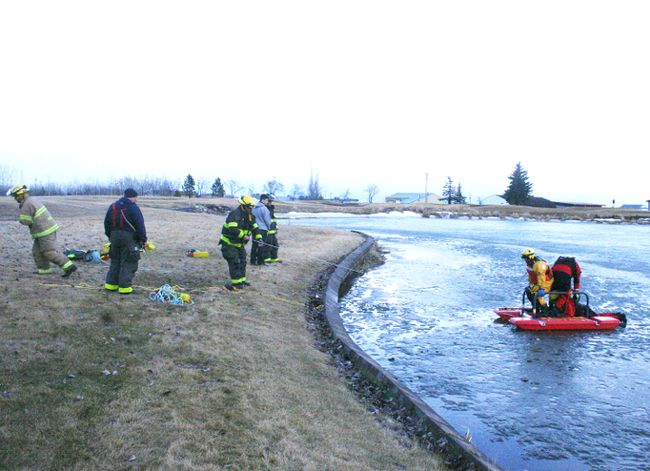 Fairview Fire Department going through a cold-water rescue scenario on the pond at GPRC Fairview College Campus.