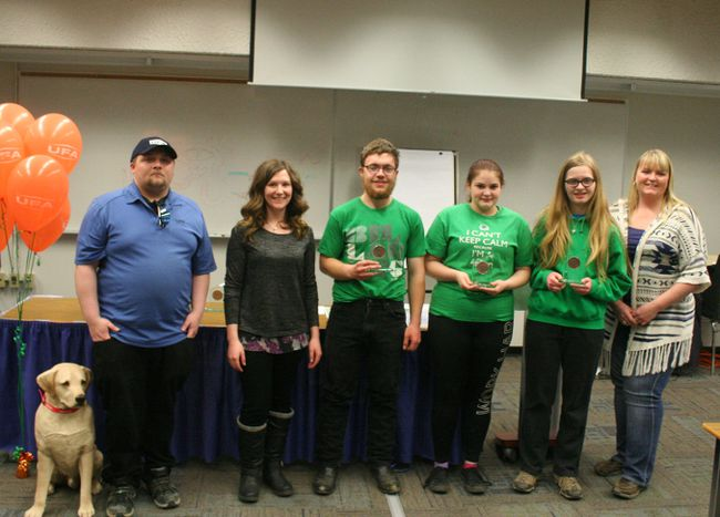 Fairview Multi-Club 4-H celebrated the achievements of some of their members April 11 following their annual general meeting. Scott Perkins, Kelsey Blake and Brittany Perkins earned Bronze for their 4-H Diaries. Scott and Brittany also earned silver. Sean Aitken of UFA Farm Supplies (far left) and Jessica Parker of ATB (second from left) presented the awards. At far right is Alberta Agriculture and Forestry 4-H specialist Peggy Stefan. Not present to accept her medallion was Zane Moffatt-Toews earned a Gold medal for her 4-H Diaries.