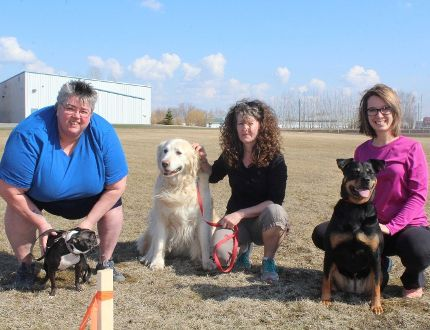 Michelle Goertzen with Queenie, Martha Olfert with Huey, and Trudy Thiessen with Rouge.