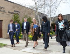 Education Minister Mitzie Hunter, second from right, leaves Paisley Central School with Bluewater District School Board officials and others on Wednesday. (Rob Gowan The Sun Times)