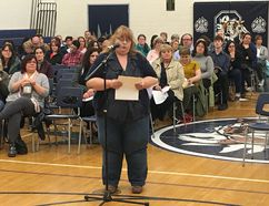 BRUCE BELL/THE INTELLIGENCER Angela McPherson speaks members of the Hastings and Prince Edward District School board at the second of two public meetings at Quinte Secondary School on Wednesday evening. The meeting was held to gather public input on the board's long-term capital and accommodation review.