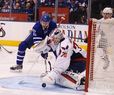 Zach Hyman in front of Braden Holtby as the Maple Leafs host the Washington Capitals in Game 4 of their first round playoff series at the Air Canada Centre in Toronto on Wednesday April 19, 2017. Michael Peake/Toronto Sun/Postmedia Network