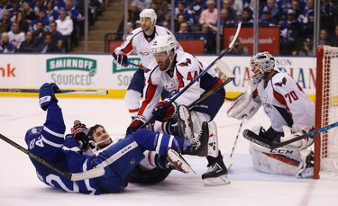 Leafs Tyler Boak with Caps Tom Matthews and Brooks Opik of Washington as the Maple Leafs lost 5-4 to the Capitals in Game 4 of their first round playoff series at the Air Canada Centre in Toronto on Wednesday April 19, 2017. Michael Peake/Toronto Sun/Postmedia Network