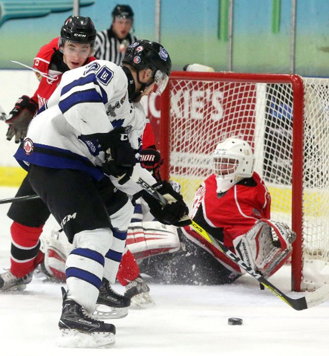Carson Brookshaw of the Nationals tries to get to a rebound while Listowel's Jakob Lee moves in to help out his goalie Brock Baier who is out of position. Brookshaw couldn't make the play during the first period of their playoff game at the Western Fair Sports Centre on Wednesday April 19, 2017.  Mike Hensen/The London Free Press/Postmedia Network