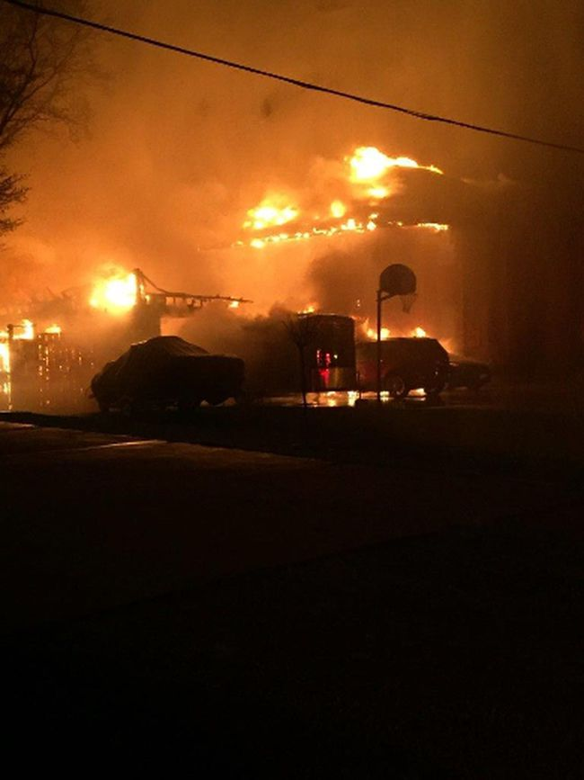 A photo provided by Lambton OPP shows a home on Victoria Street in Camlachie engulfed in flames overnight Thursday. Police said all of the residents of the home escaped safely and the cause of the fire is being investigated by the Ontario  Fire Marshal's office.