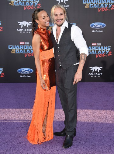 """Zoe Saldana, left, and Marco Perego arrive at the world premiere of """"Guardians of the Galaxy Vol. 2"""" at the Dolby Theatre on Wednesday, April 19, 2017, in Los Angeles. (Photo by Jordan Strauss/Invision/AP)"""