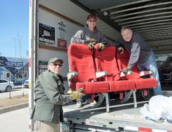 Ron Hall, Peter Holfeuer and Steve Bannister unload airline seats for the Gimli Glider Exhibit's theatre area. (Juliet Kadzviti/The Interlake Spectator/Postmedia Network)