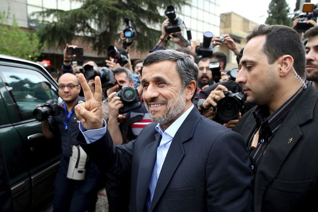 In this Wednesday, April 12, 2017 file photo, former Iranian President Mahmoud Ahmadinejad flashes the victory sign as he arrives at the Interior Ministry to register his candidacy for the upcoming presidential elections, in Tehran, Iran. Over 1,600 people registered to run. Under Iranian law, there's no fee for registering. Hopefuls only must believe in Iran's form of government and be Shiite Muslims. (AP Photo/Ebrahim Noroozi, File)
