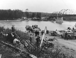 The August 1949 opening of the highway bridge across the Smoky River was a historic event for the South Peace. The three-truss bridge replaced the ferry which had, in one form or another, served travellers since 1911. South Peace Regional Archives