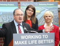 Transportation Minister Brian Mason announces the Highway 15 bridge twinning project in Fort Saskatchewan, accompanied by Fort Saskatchewan MLA Jessica Littlewood (centre) and Mayor Gale Katchur on March 23.