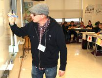PAUL KRAJEWSKI HIGH RIVER TIMES/POSTMEDIA NETWORK. Tim Huesken, a graphic designer and animator, leads a workshop on story illustration during the 28th annual Young Author's Conference at Ècole Highwood High School on April 8 in High River, Alta.