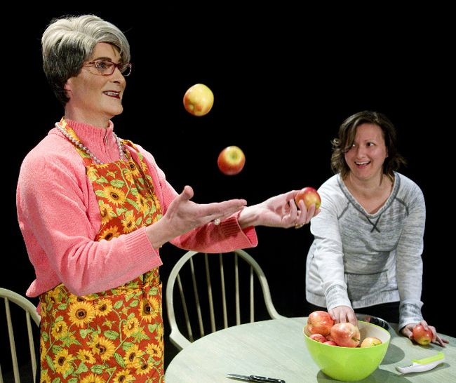 Carl Whelan, as the title character, shows Dominque Kamras, playing Molly, how to juggle in Ms. Cransen, written by Tricia West at the Arts Project. (MIKE HENSEN, The London Free Press)