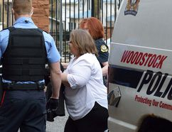Elizabeth Wettlaufer is led into court in Woodstock Friday morning. MORRIS LAMONT/POSTMEDIA NETWORK