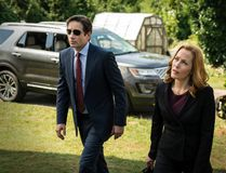 """This photo provided by FOX shows, David Duchovny, left, as Fox Mulder and Gillian Anderson as Dana Scully in an episode of """"The X-Files."""" Fox said Thursday it has ordered a second chapter of what it's calling an """"X-Files"""" """"event series."""" The 10-episode series will air during the upcoming 2017-18 TV season. (Ed Araquel/FOX via AP)"""