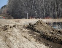 Water pooling beside highway 255 is destroying the road to Tobin Lake.