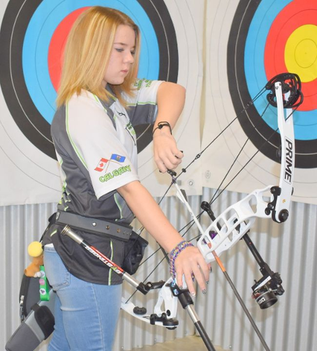 Haley Priest lines up a shot with her bow.