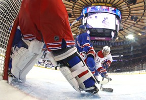 Brendan Gallagher #11 of the Montreal Canadiens shoots the puck against Marc Staal #18 and Henrik Lundqvist #30 of the New York Rangers n Game Six of the Eastern Conference First Round during the 2017 NHL Stanley Cup Playoffs at Madison Square Garden on April 22, 2017 in New York City. (Photo by Bruce Bennett/Getty Images)