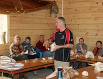 Jamie Honderich showing off a the skulls of an Arctic and Algonquin wolf during his Skulls and Such workshop at Shaw Woods Education Centre.