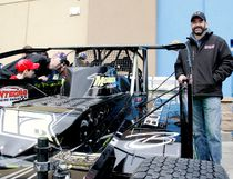 Danny O'Brien, right, last year's Brockville Ontario Speedway 358 Modifieds champion, poses by his new car at Saturday's BOS Fan Fest and CHEO Fundraiser in the Walmart parking lot. At left, Marc Menard, of Cornwall, and his son, Jonathan, take a look inside. (RONALD ZAJAC/The Recorder and Times)