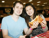 Husband and wife, Richard Pawliszyn and Christine Liu of London split a gooey grilled cheese sandwich at the second annual Dairy Capital Cheese Festival at Oxford Audictorium on Saturday, April 22, which was transformed into a Turophile's - a fancy name for cheese lovers - paradise. JOHN TAPLEY/SENTINEL-REVIEW