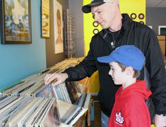 Geoff Jarvis and his 9-year-old son, Ryan, browse records at Diamond Dogs Vinyl on Saturday, April 22, 2017 in Stratford, Ont. Record Store Day made its annual return. Terry Bridge/Beacon Herald/Postmedia Network