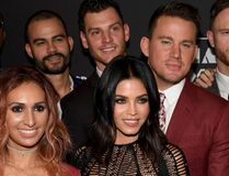 """(L-R, front) Cast member Mark Shunock, associate director and choreographer Teresa Espinosa, actress Jenna Dewan Tatum, actor Channing Tatum and cast member Lyndsay Hailey attend the grand opening of """"Magic Mike Live Las Vegas"""" with other cast members at the Hard Rock Hotel & Casino on April 21, 2017 in Las Vegas, Nevada. (Ethan Miller/Getty Images)"""