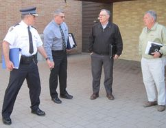 Members of the Norfolk Police Services Board decide their next move Monday morning after Governor Simcoe Square was evacuated due to an odor of natural gas. The PSB was forced to evacuate the council chamber and reconvene at Norfolk OPP headquarters on the Queensway West. From left are Insp. Zvonko Horvat, chief of the Norfolk OPP, Staff Sgt. Joe Varga, Mayor Charlie Luke and Dave Murphy of Port Dover. MONTE SONNENBERG / SIMCOE REFORMER