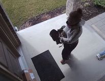 A surveillance camera video showing a woman taking a parcel from a doorstep — an incident now under investigation by police — has raised questions about theft in a world where cameras, videos and their airing on social media is so pervasive. (YouTube)