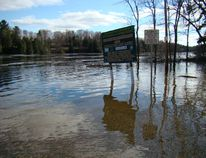 Photo by Patricia Drohan/For The Mid-North Monitor On the west side of the bridge into Espanola, the Spanish River is running very fast and high this year. The cement boat launch is completely under water and the river is up about 15 feet on the shoreline.