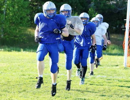 Graeme Stevens leads the Sudbury Gladiators through drills last season. Stevens is one of three local football players committed to Canadian university football next year who have decided to return to the Gladiators for summer football. Gino Donato/The Sudbury Star