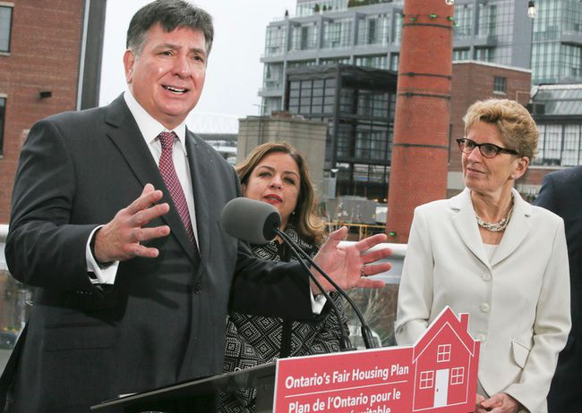 Ontario's Finance Minister Charles Sousa along with Premier Kathleen Wynne announce the Liberals Fair Housing Plan in Liberty Village on April 20, 2017 in Toronto. Veronica Henri/Toronto Sun/Postmedia Network