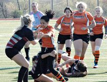 North Park Collegiate's Sam Terpstra fights off a tackle by an Assumption College Lions player on Monday at Pauline Johnson Collegiate during a senior girls rugby game. (Brian Smiley/The Expositor)