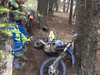 A dirt bike lays on the ground after a close encounter with barbed wire in Porcupine Hills. | Facebook photo