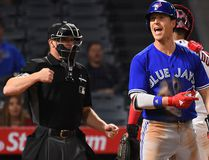 Chris Coghlan #7 of the Toronto Blue Jays reacts after called out on a checked swing by umpire Toby Basner #99 in the ninth inning of the game against the Los Angeles Angels at Angel Stadium of Anaheim on April 24, 2017 in Anaheim, California. Angels won 2-1. (Photo by Jayne Kamin-Oncea/Getty Images)