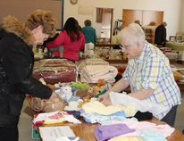 Bargain hunters were at the All Saints Anglican Church rummage sale on Thursday, April 20, looking for deals.