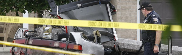 Ottawa police investigate a fatal crash as a possible street-racing incident in this 2010 file photo.