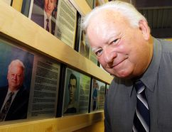 The late Jon Gibbons checks out his plaque when he was inducted into the Quinte West Sports Wall of Fame in 2013. He died Sunday at the age of 70. (Intelligencer file photo by Luke Hendry)