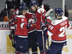 Forward Tyler Wong (No.5) and defenceman Brady Pouteau (No. 28) of Lethbridge Hurricanes celebrate a goal with teammates against the Regina Pats in second period of Game 2 at the Brandt Centre in Regina on April 21, 2017. The Hurricanes won 3-1.