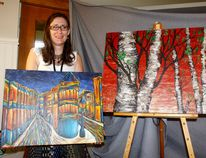 Foothills Art Club Christine Mayhew poses with her painting during Foothills' Spring Show and Sale, April 8.
